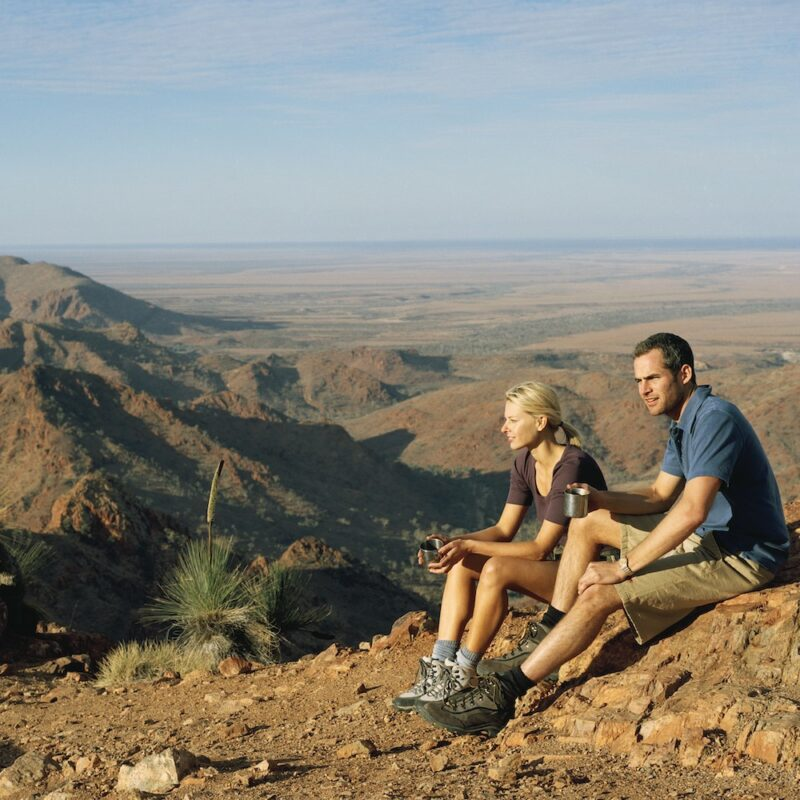 Couple sitting on a rock. The view from Sillers Lookout