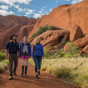 Walking Uluru with tour guide